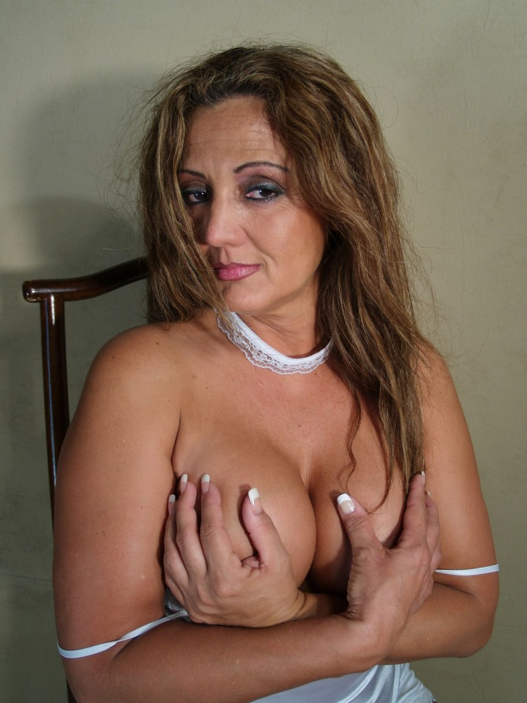 The hot and sexy Latina Milf Hotlips Melanie's deep cleavage.