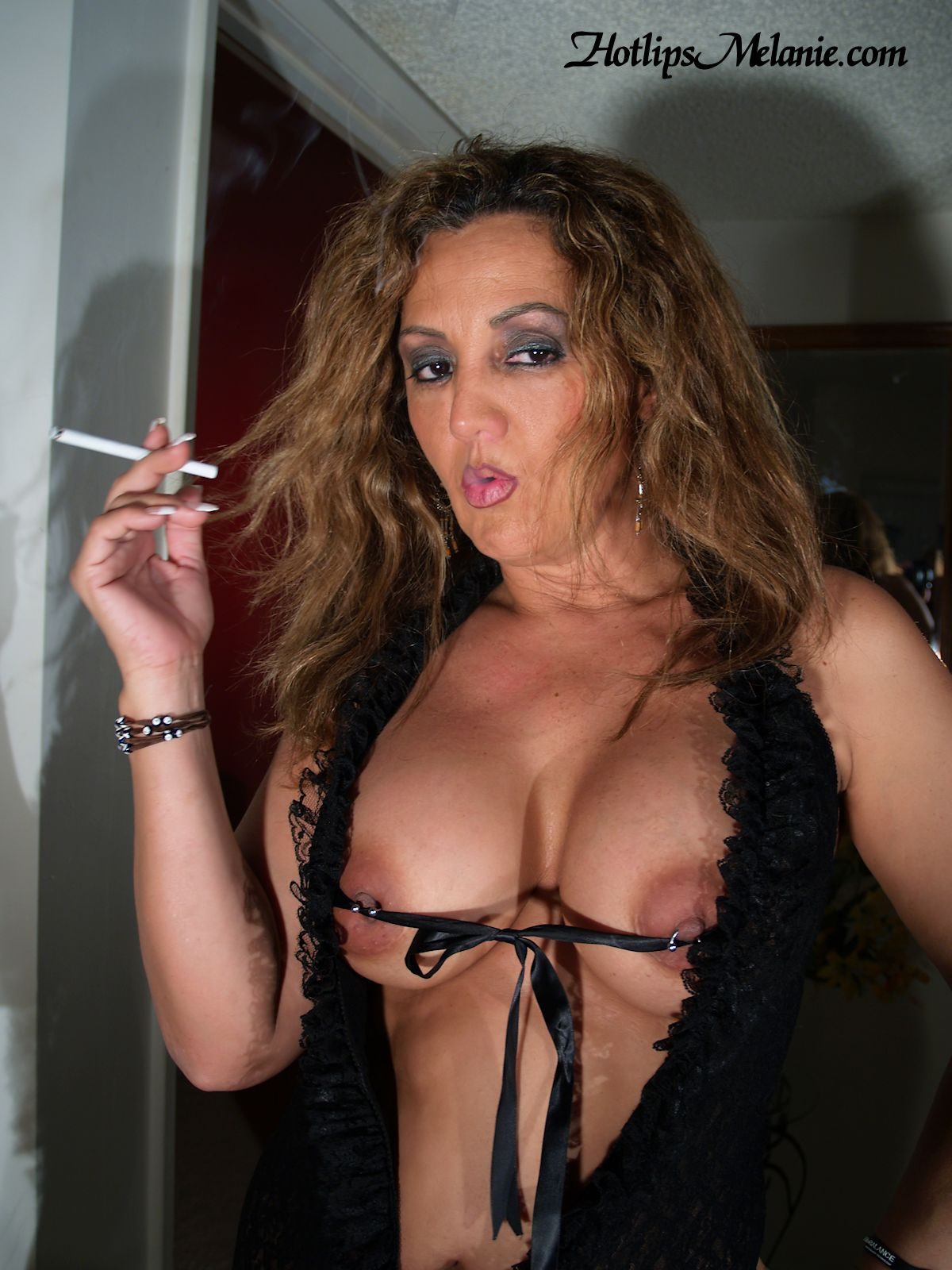 Big tit women smoking