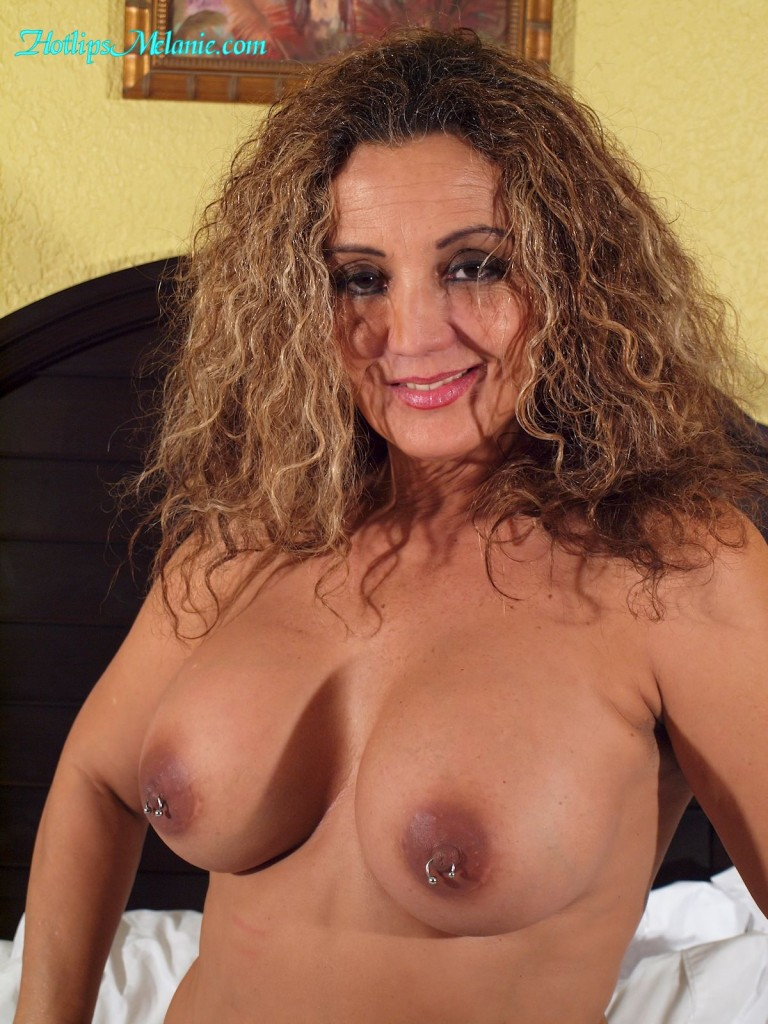 Hotlips Melanie's big tits and pierced nipples exposed.