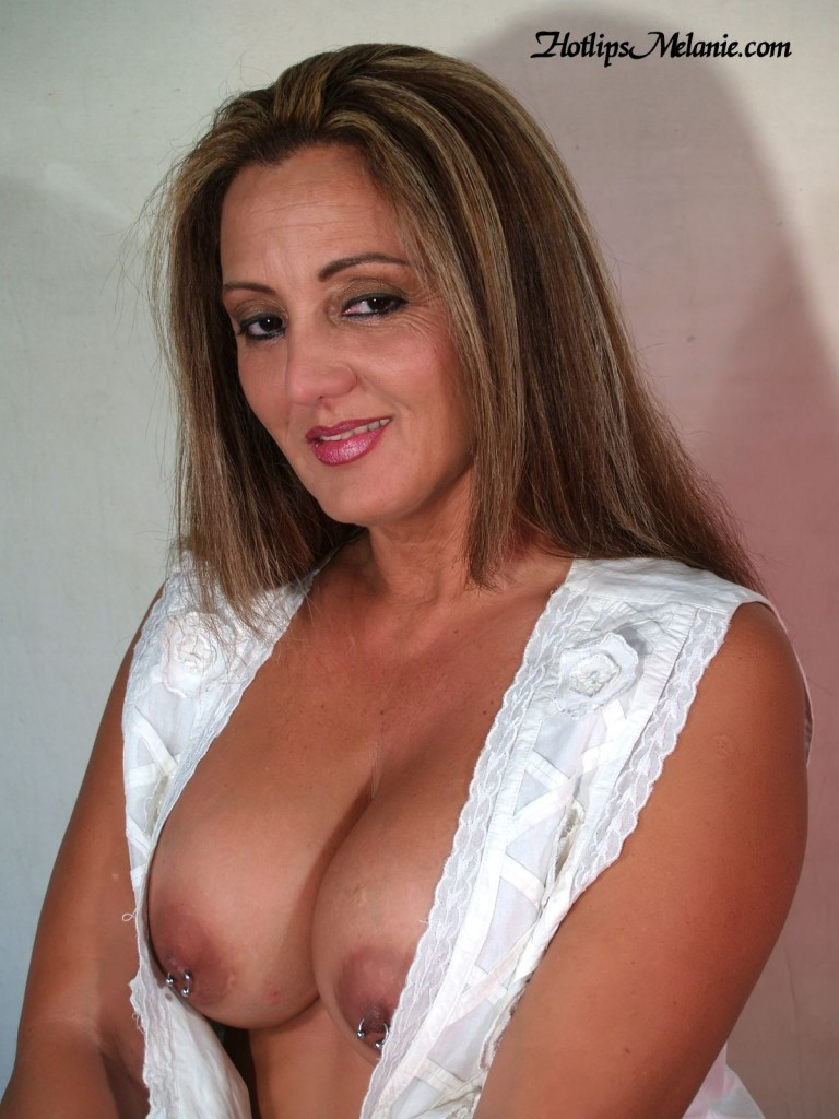 Melanie Hotlips, the Latina milf, exposed her big tits and pierced nipples..