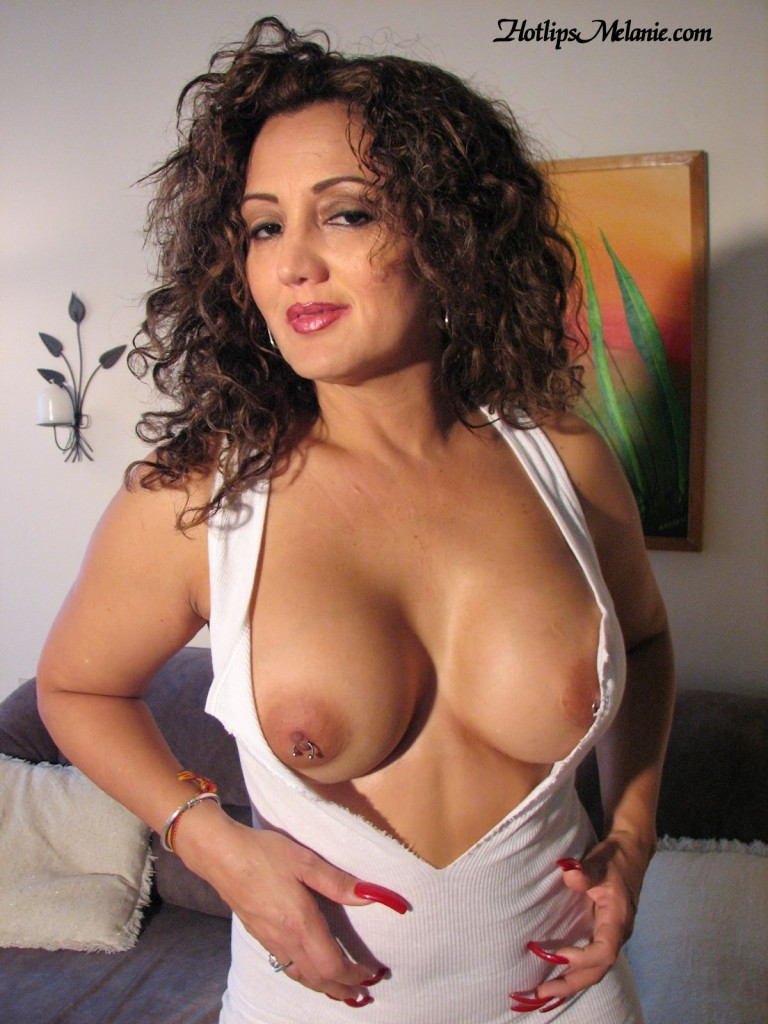 Big tits, deep cleavage, pierced nipples, and long finger nails. There is nothing sexier on a Latina milf.