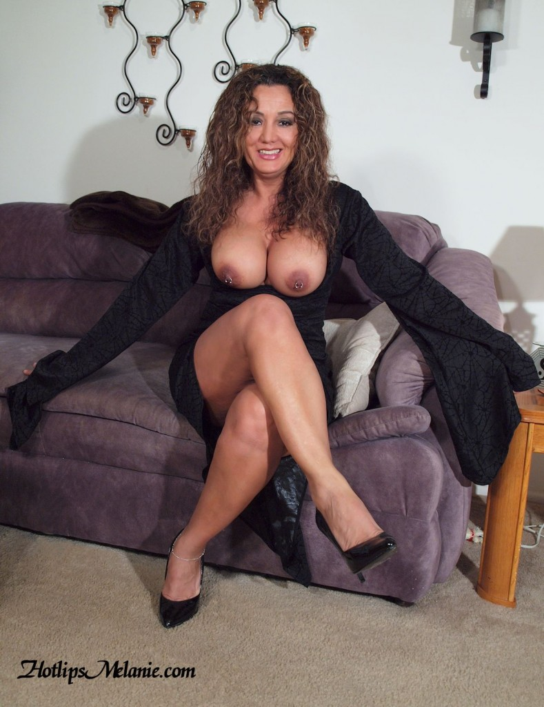 The big tit, pierced nipple, Latina Milf, Hotlips Melanie, in a short skirt and high heels.