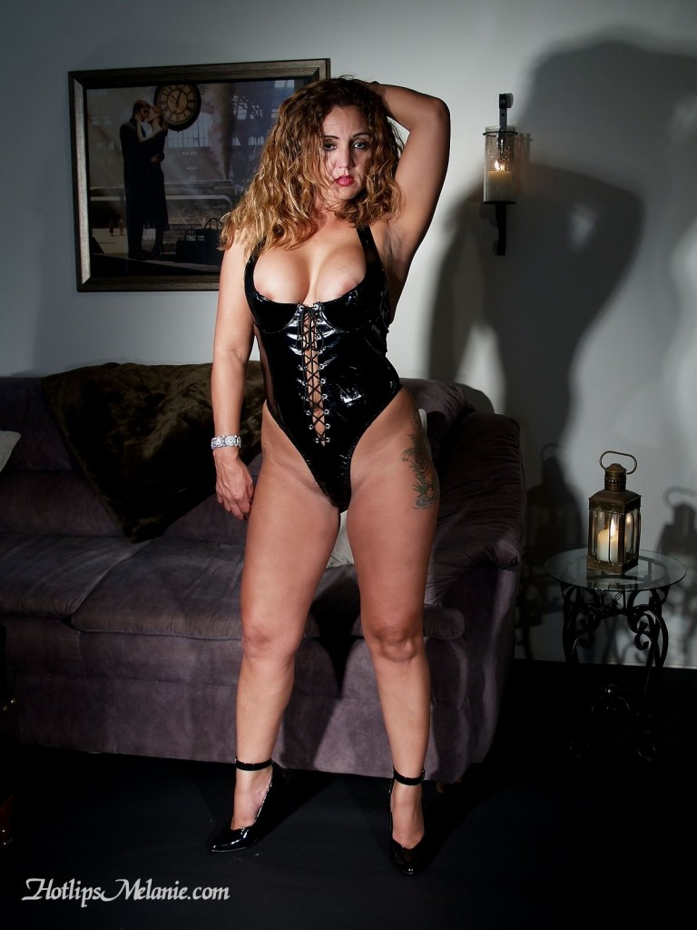 Hotlips Melanie dominates with her strong legs and big tits. Her slaves secome the the voluptuous sexual Goddess.