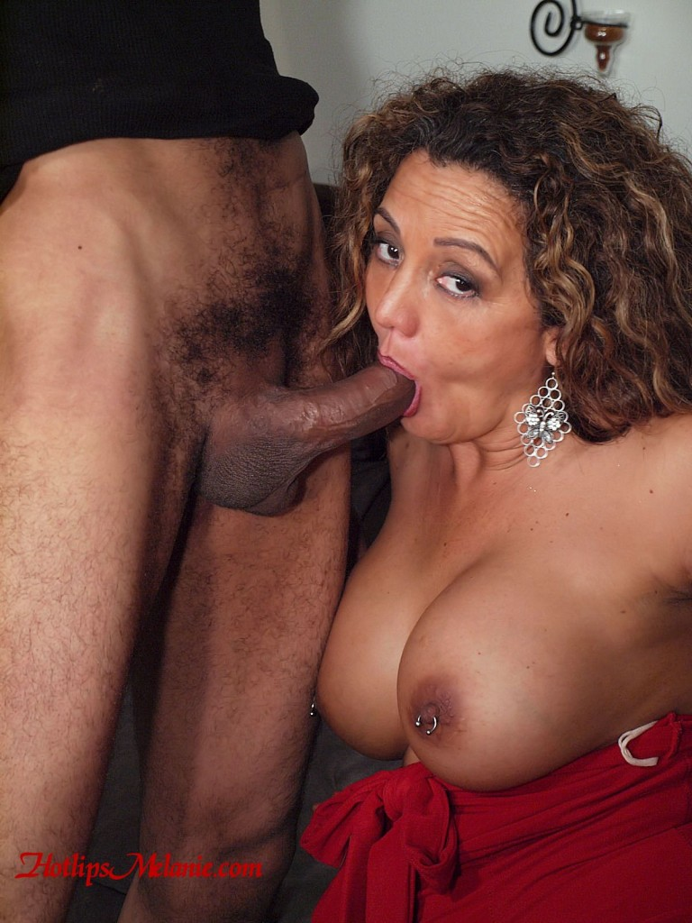 Hotlips Melanie deep throats a big black cock in an interracial blow job session.