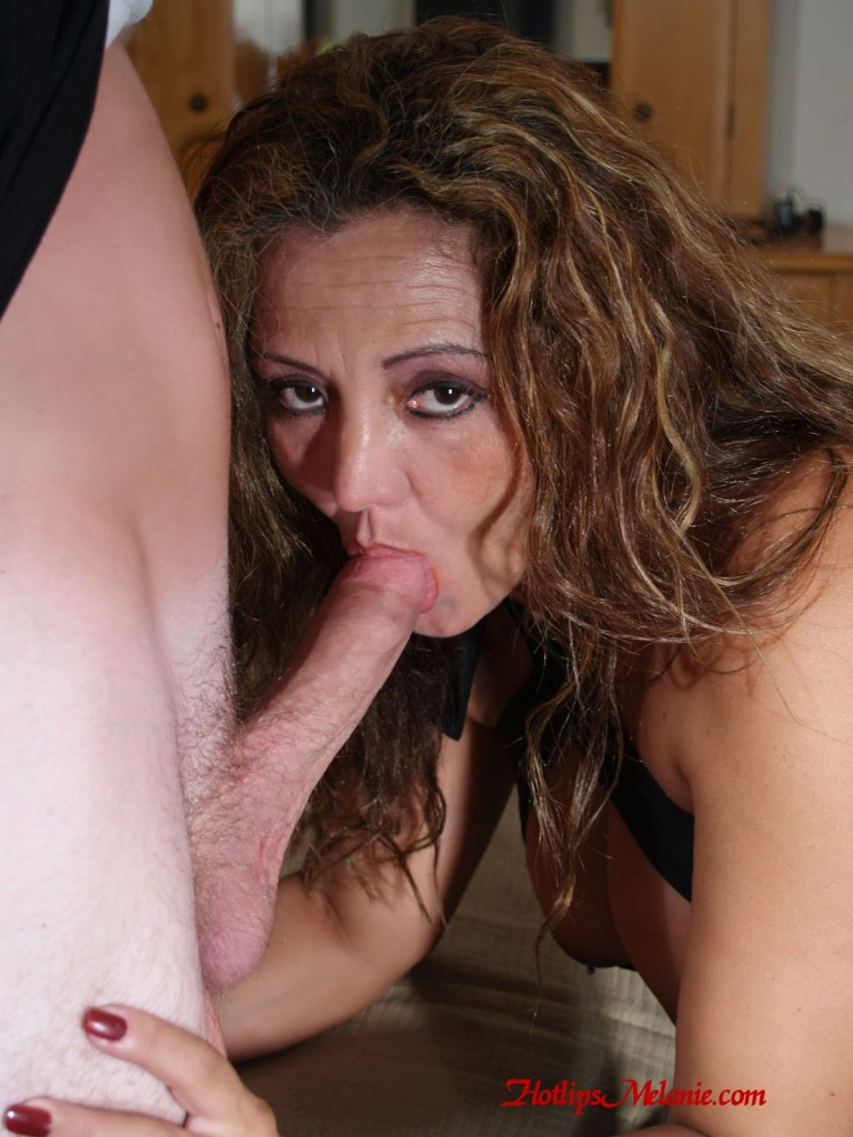 Hotlips Melanie sucks a monster cock, giving a deep throat blow job.
