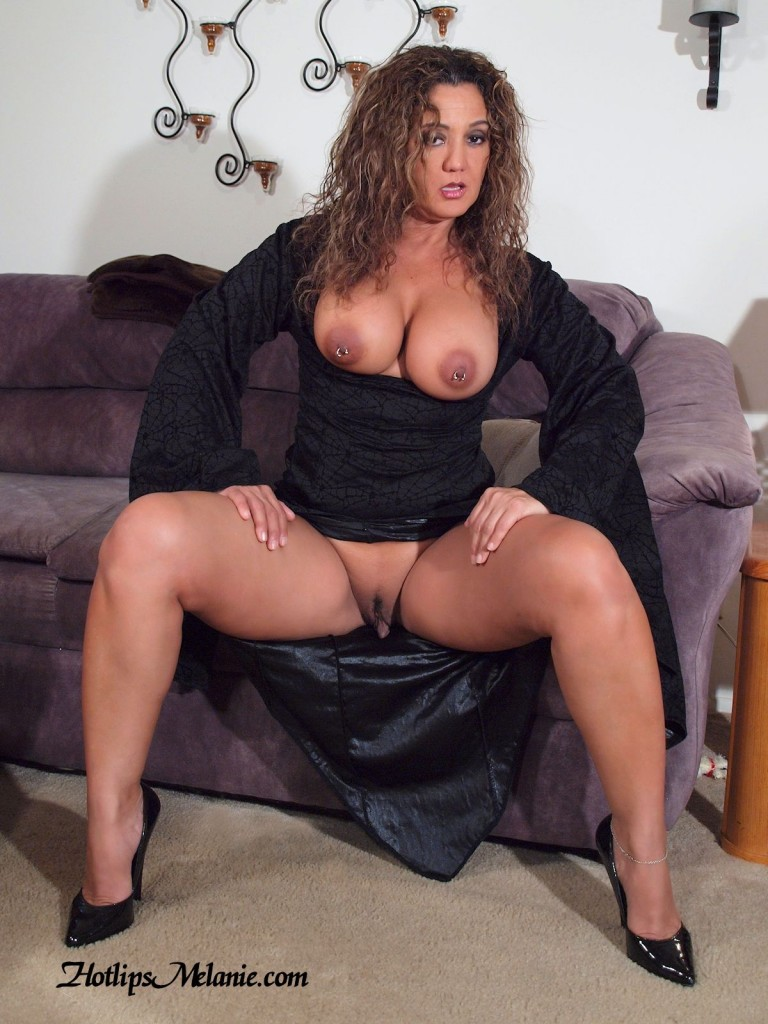 Hotlips Melanie spreads her sexy high heeled legs and exposes her large labia.