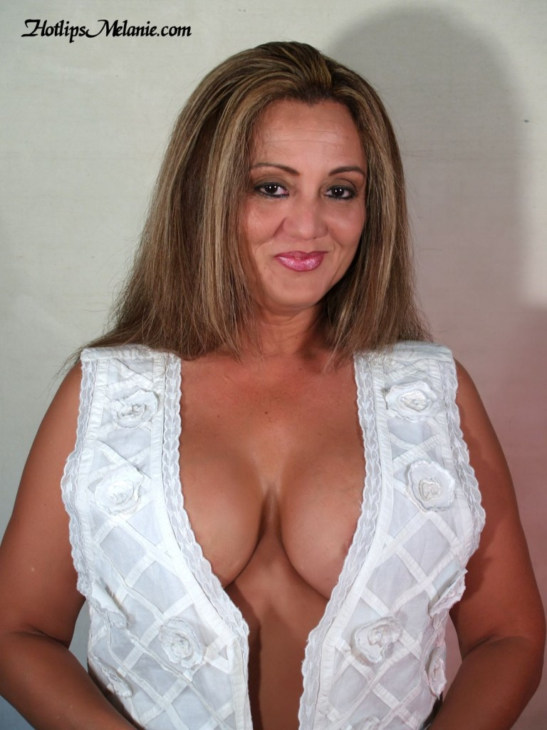 The deep cleavage and big tits of the Colombian Latina milf, Hotlips Melanie