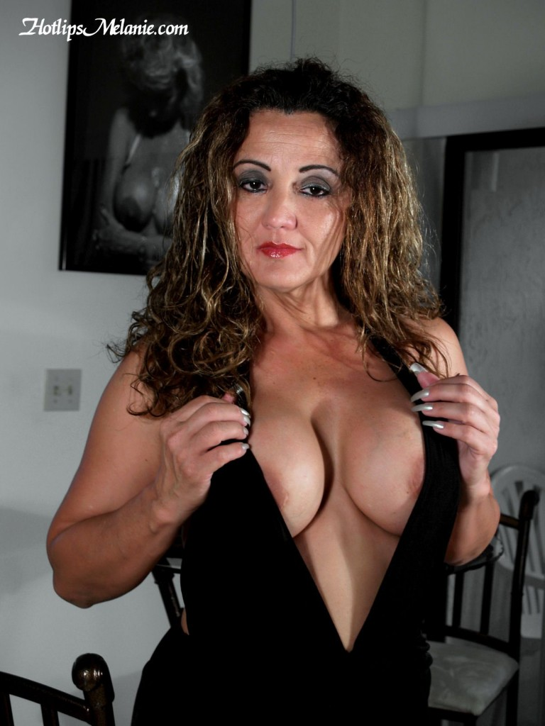 Hotlips Melanie's big tit deep cleavage and long finger nails. She is one sexy Latina Milf!