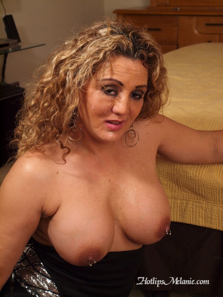 Melanie Hotlips is a cum covered, facialized Latina Milf, showing off her big tits and pierced nipples.
