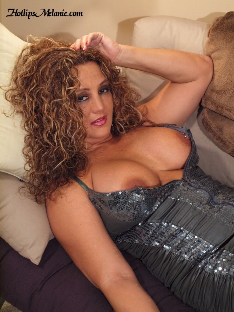 The Latina Milf, and porn star, Hotlips Melanie, does a big tit and deep cleavage glamour shoot. Her pierced nipples are exposed.