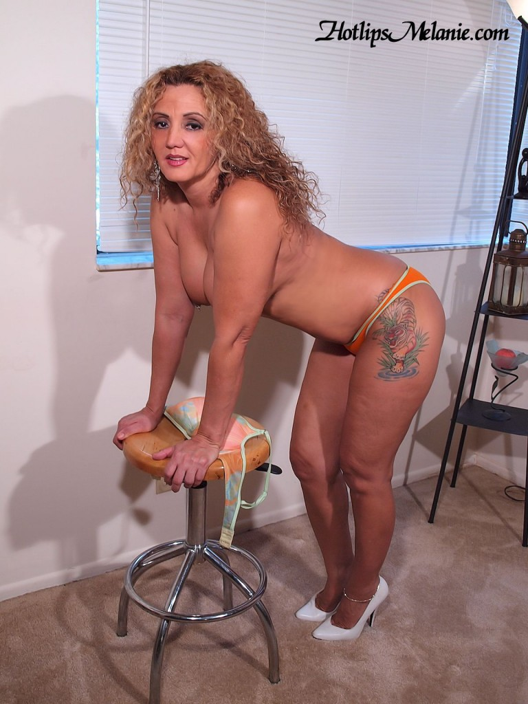 Big booty, Latina milf, Hotlips Melanie in high heels, showing her big tits and sexy legs.