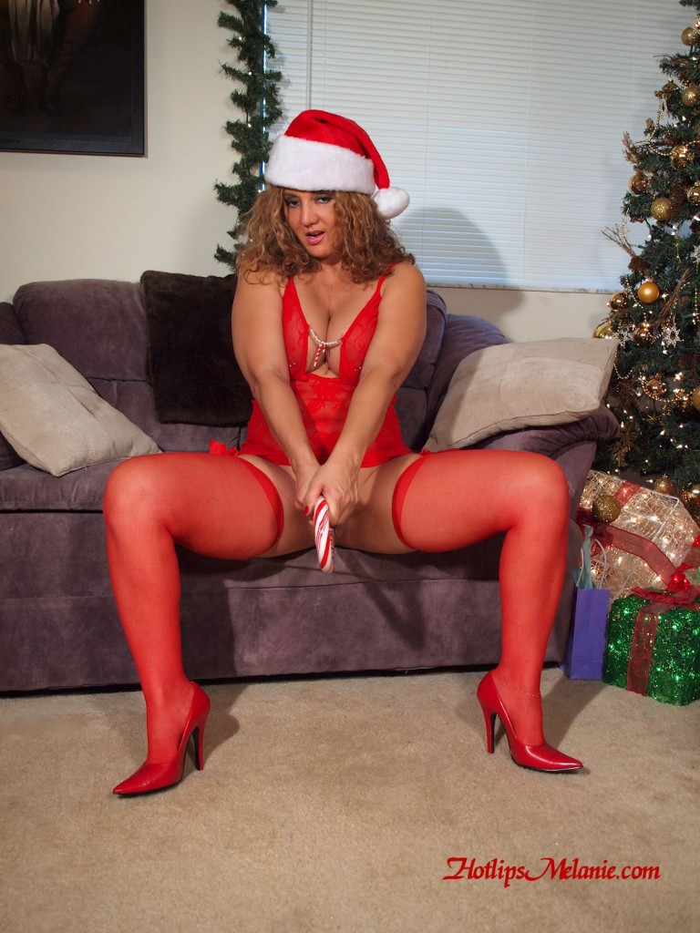Latina milf, Hotlips Melanie spreads her high heeled legs, and pussy lips, to insert a candy cane.