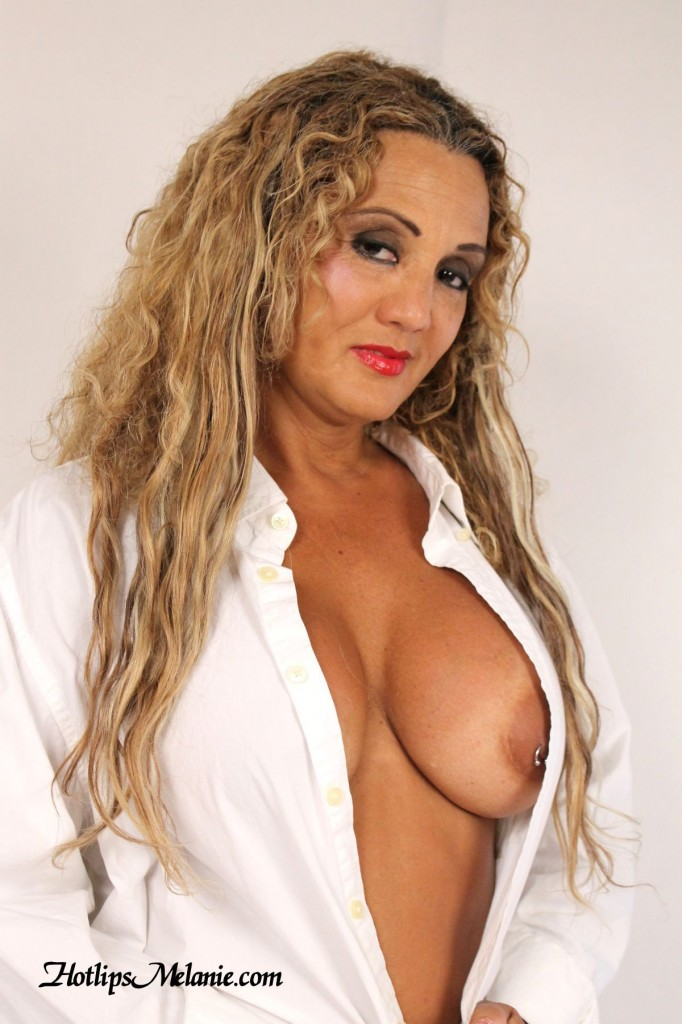 Big tit Colombian milf, Hotlips Melanie, is ready to give head.