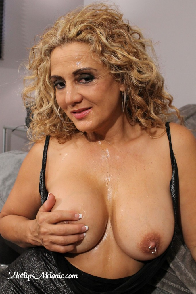 Big tit Latina Milf has a face covered in cum after giving a blowjob.