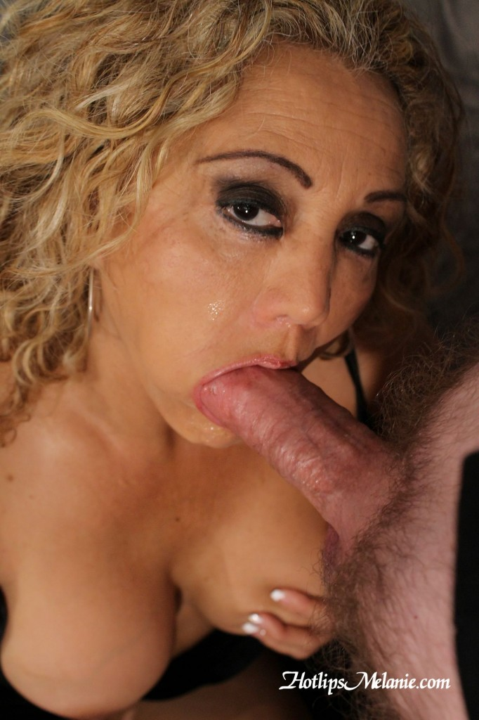 Hotlips Melanie is jaw fucked by a big dick, before getting a cum covering facial.