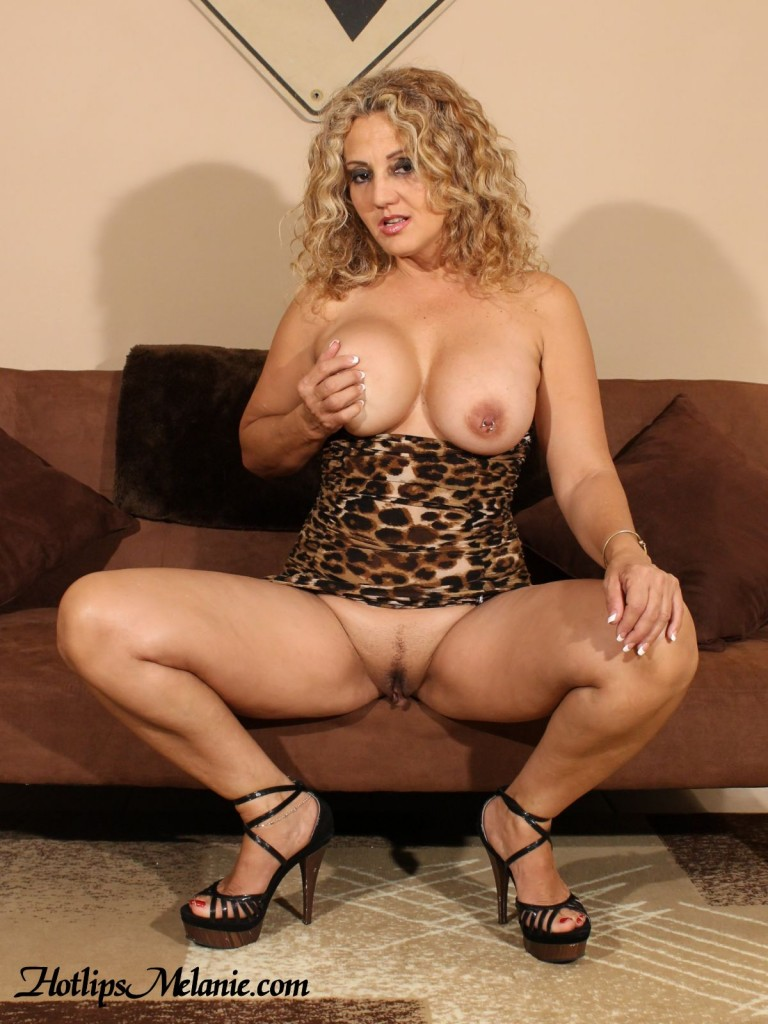Latina Milg, Hotlips Melanie, spreads her sexy legs and exposes her large labia.