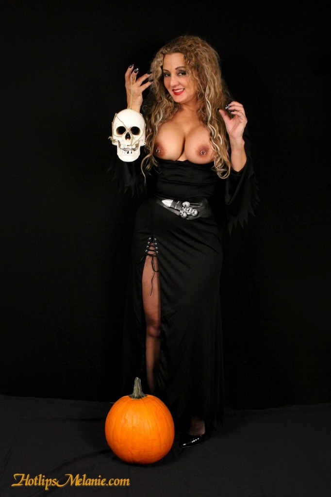 Melanie's big tits are popping out of her witch Halloween costume.