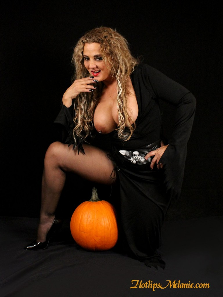 Melanie shows off her sexy high heeled legs and big tits in her Halloween witch costume.