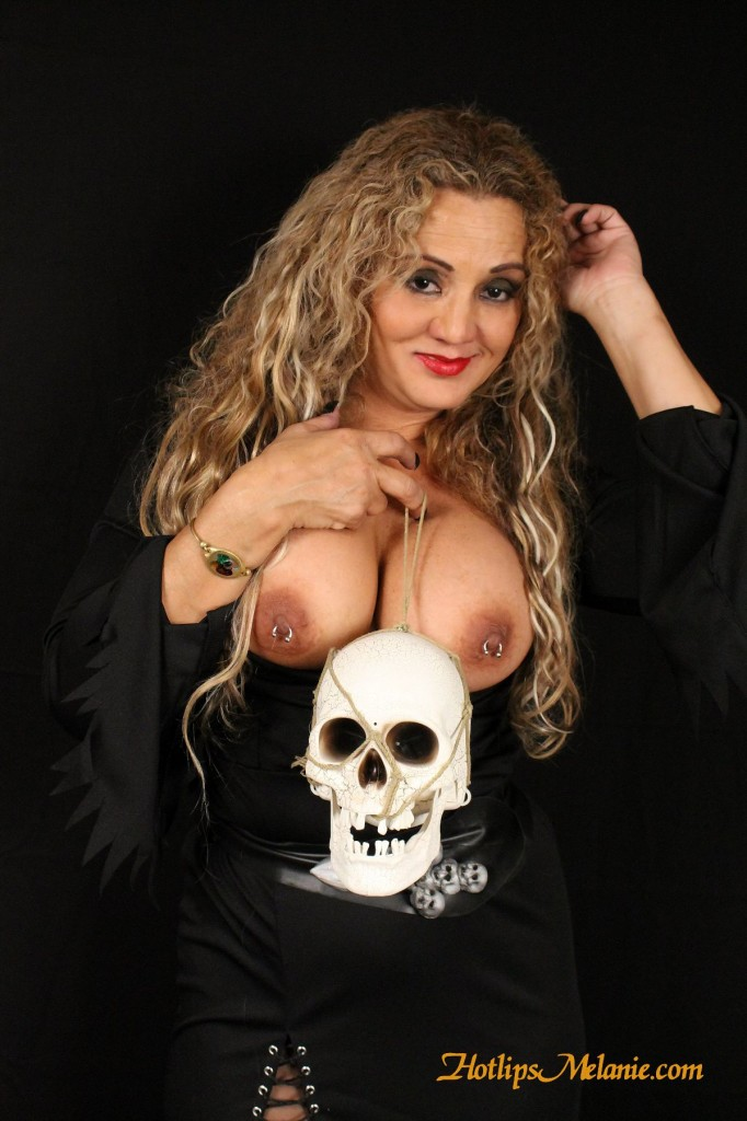 Hotlips Melanie's bewitching boobs and pierced nipples.
