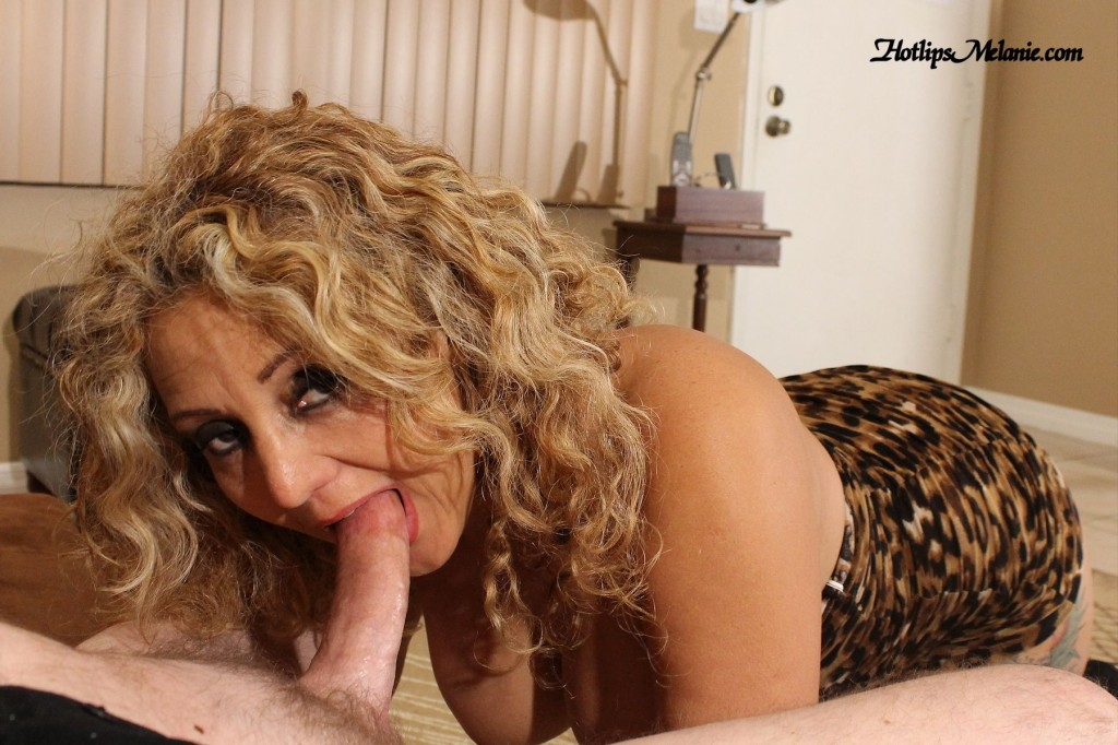 Latina milf opens her mouth wide to suck a big cock.