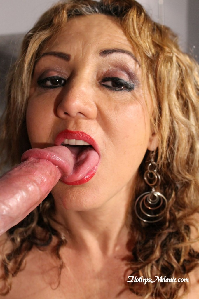 Mom with red hot lips licks a big dick with her tongue.
