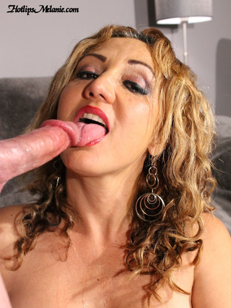 Mature milf opens wide to suck cock with her hot lips.