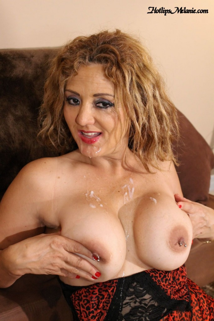 Hotlips Melanie gets a massive cum load shot on her big tits after giving head.