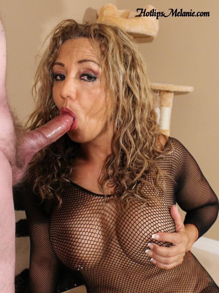 Hotlips Melanie is sucking cock wearing a body stocking.