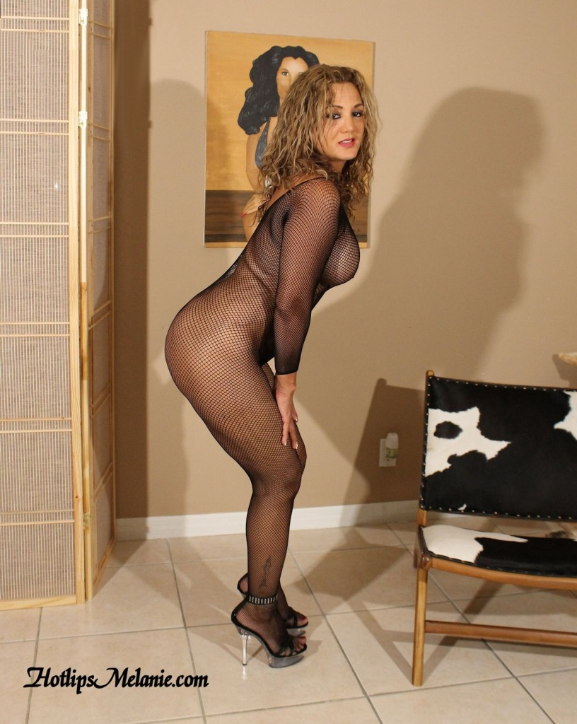 Hotlips Melanie is dressed in a see through body stocking.