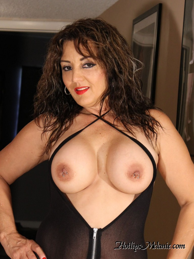 Latina Milf showing off her big tits and pieced nipples