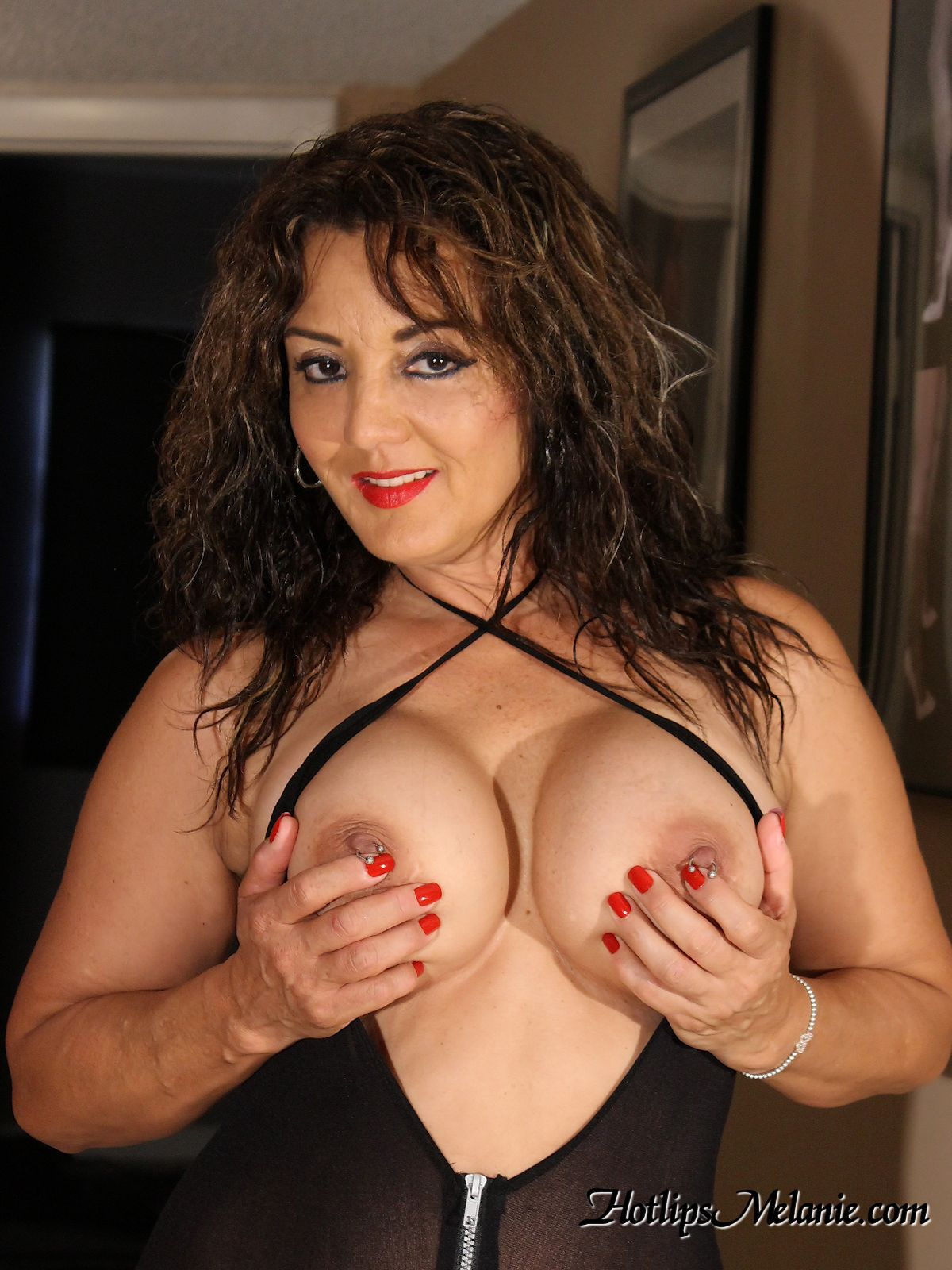 Big tit Latina hand bra with pierced nipples exposed