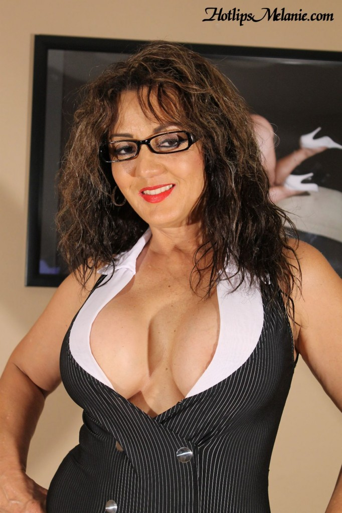 Big tit secretary shows off her deep cleavage.