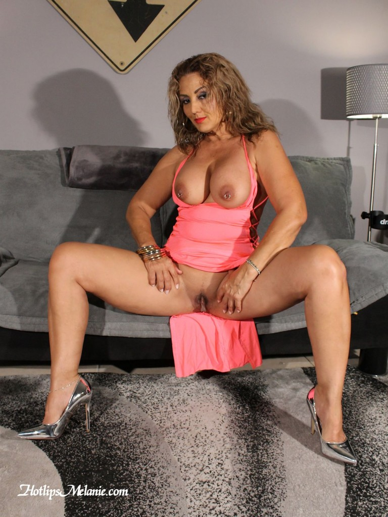 Melanie spreads her high heeled legs and exposed her meaty labia lips.