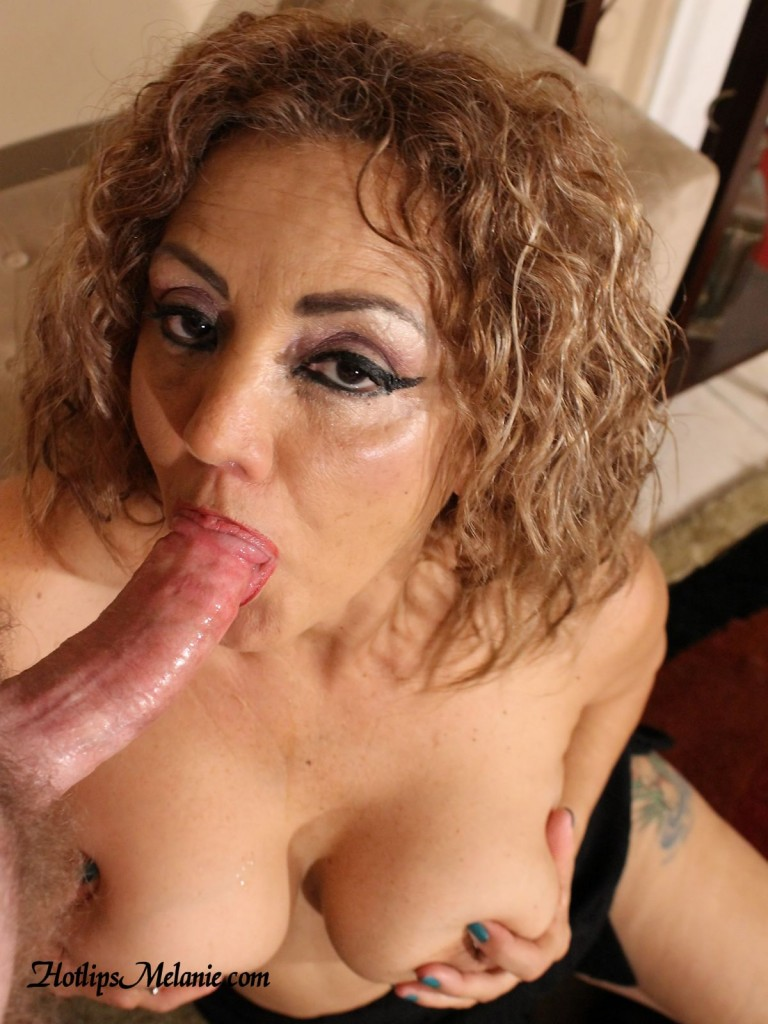 Hotlips Melanie wraps her lips around a hard cock.